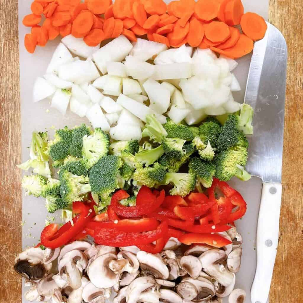 vegetable lo mein veggies on a cutting board
