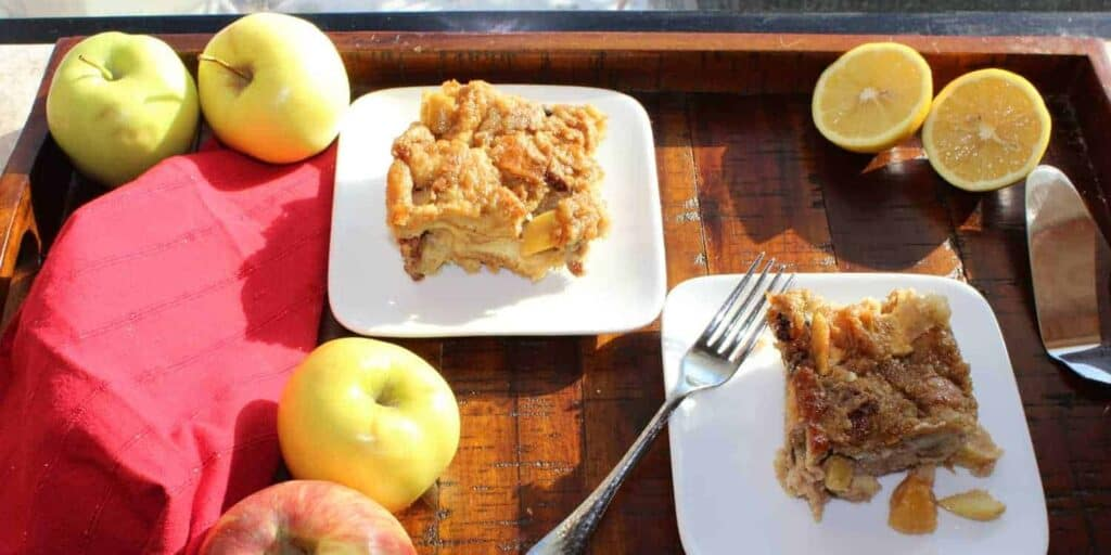 bread pudding on a plate with a napkin and apples