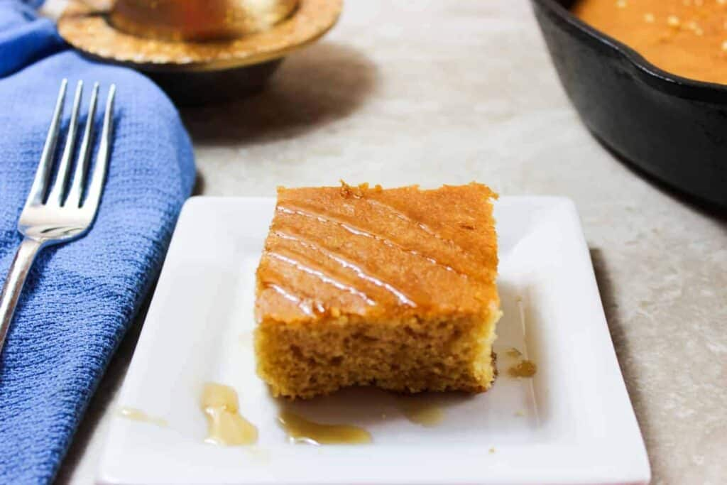 cornbread on a plate with a fork