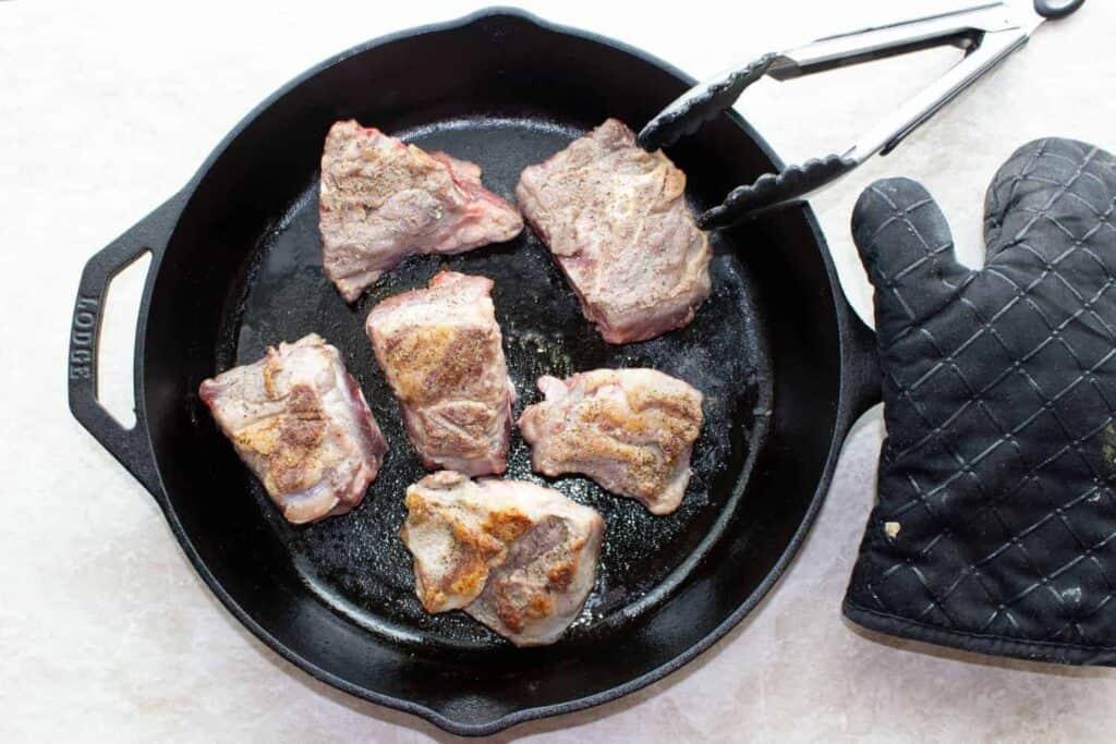 browned lamb in the pan