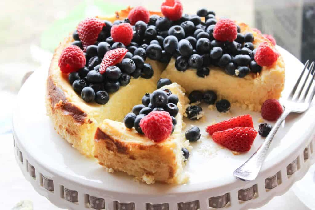 passover cheesecake on a plate with berries