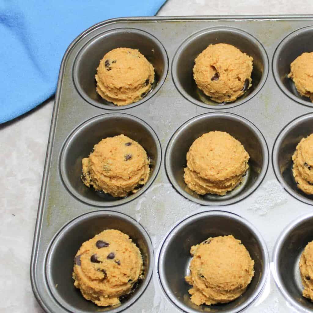 spiced pumpkin muffins in a muffin tin