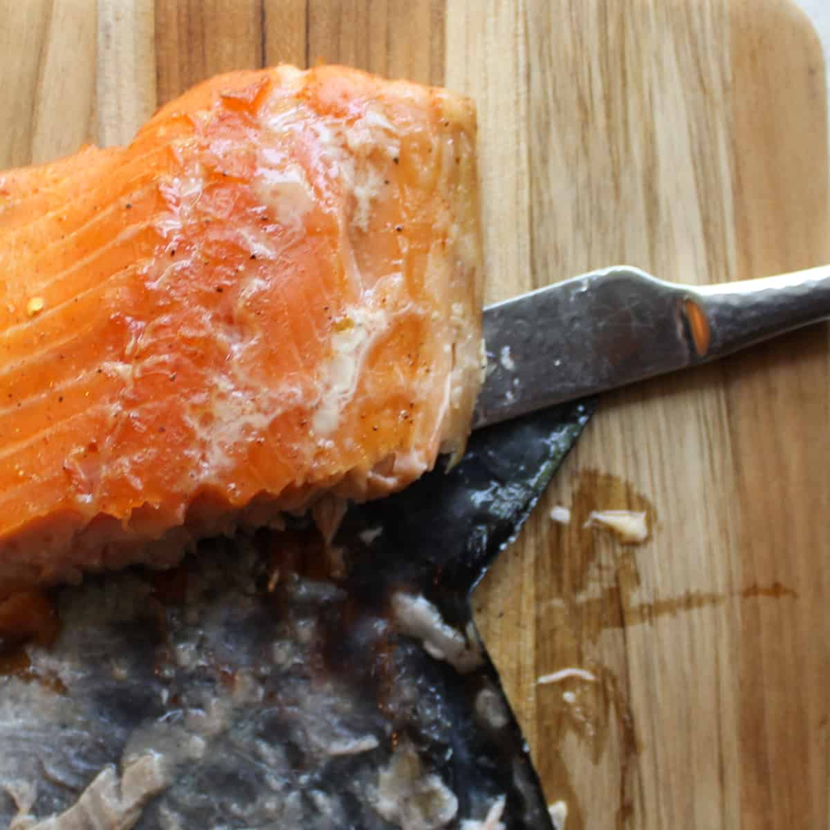 removing the skin from smoked salmon using a butter knife