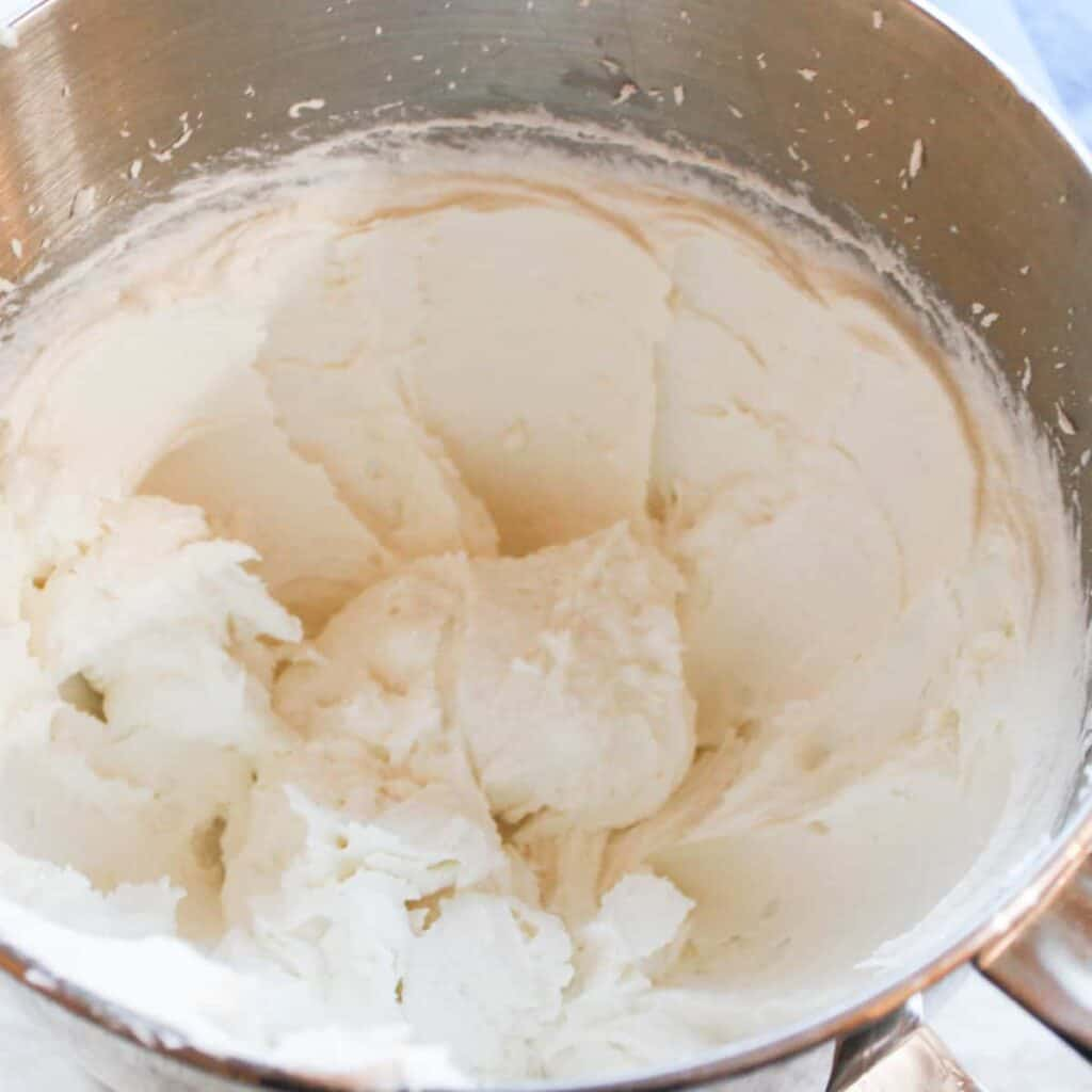 vanilla frosting in a mixing bowl