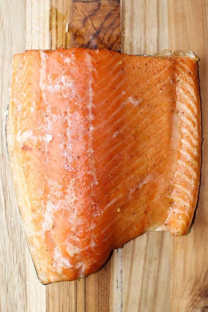 smoked salmon on a bamboo cutting board