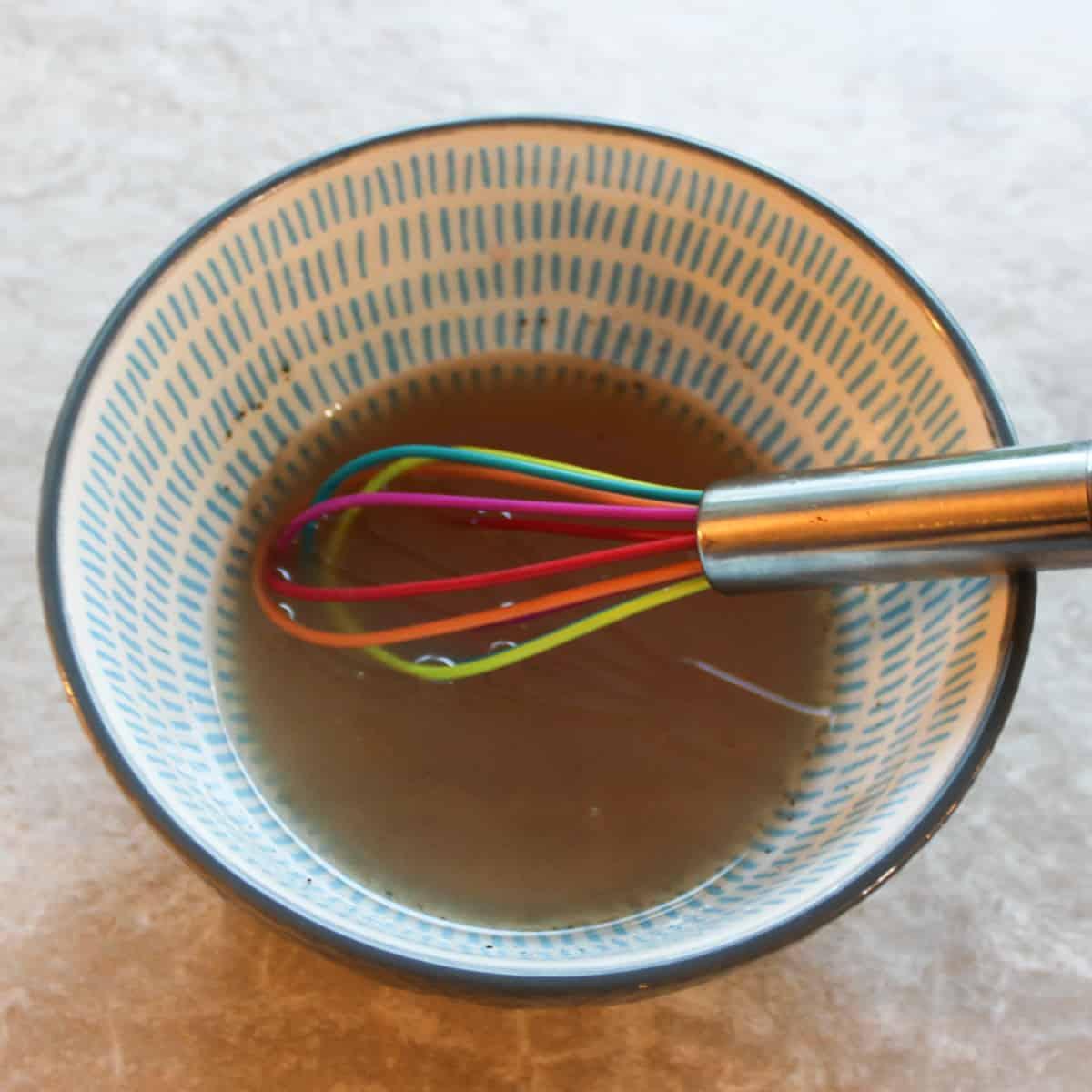 whisk together oil and vinegar