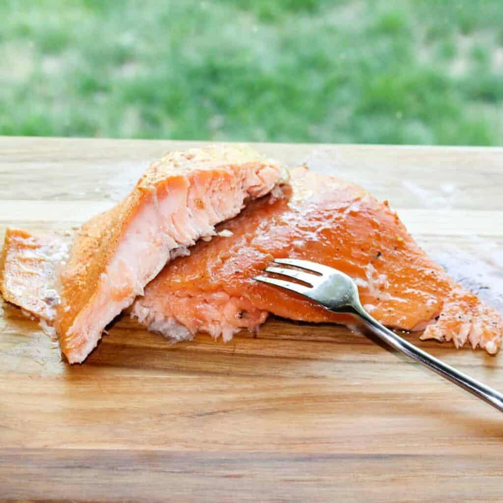 homemade brown sugar smoked salmon with a fork