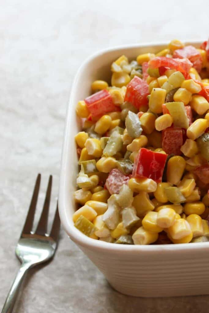summertime corn salad served in a bowl with a fork on the side