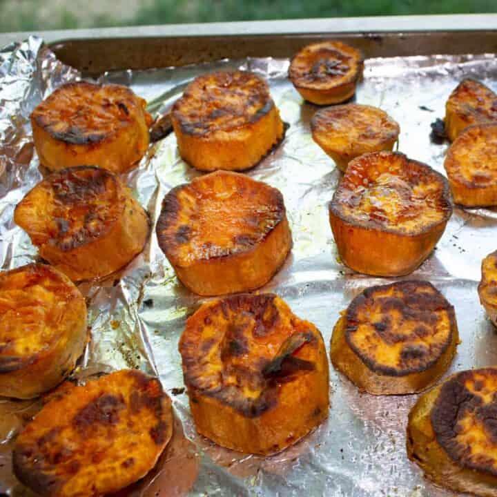 sweet potato medallions on a baking sheet
