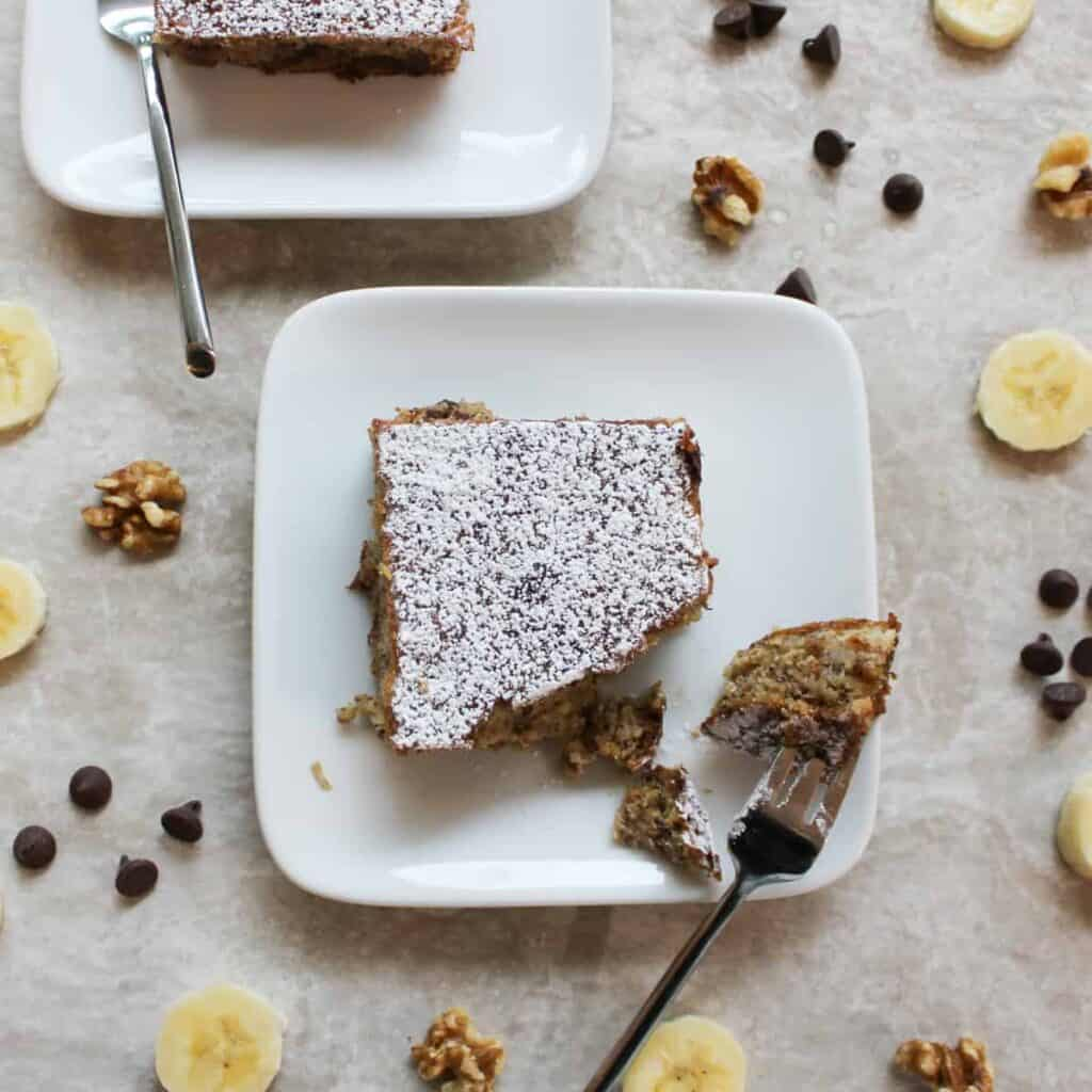 banana cake surrounded by chocolate chips and banana slices