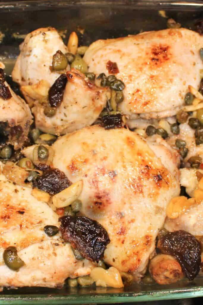 chicken marbella in a baking dish
