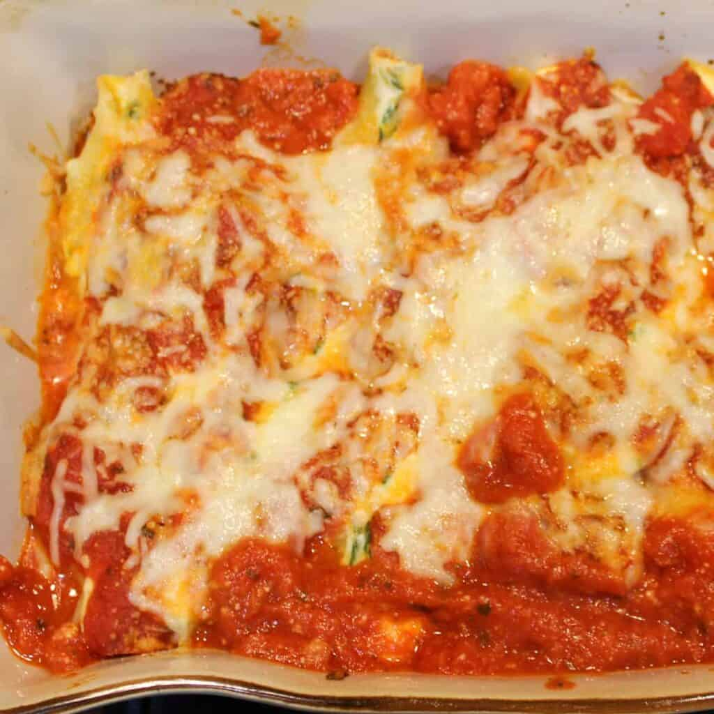 stuffed shells out of the oven with browned cheese and bubbling sauce